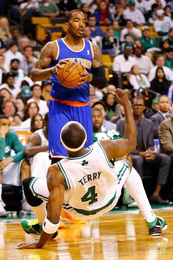 J.R. Smith of the Knicks elbows Jason Terry