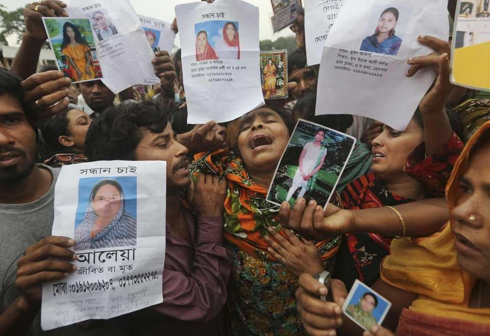 Bangladeshi relatives of garment worker Mohammed Abdullah cry