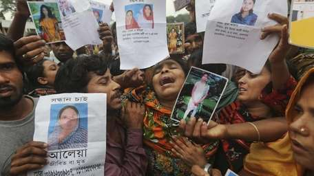Bangladeshi relatives of garment worker Mohammed Abdullah cry