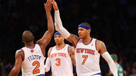 Carmelo Anthony of the Knicks celebrates with Raymond