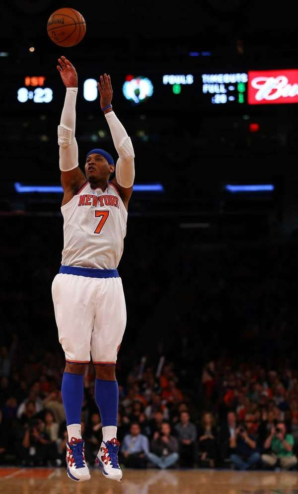 Carmelo Anthony of the Knicks shoots a three-point