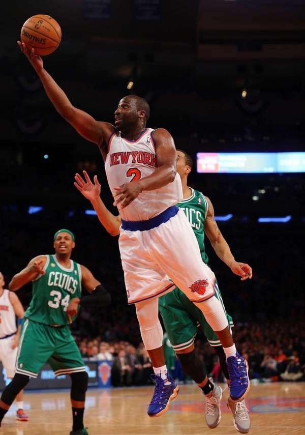 Raymond Felton of the Knicks heads for the