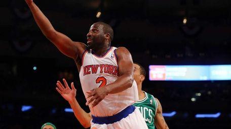 Raymond Felton of the Knicks heads for the