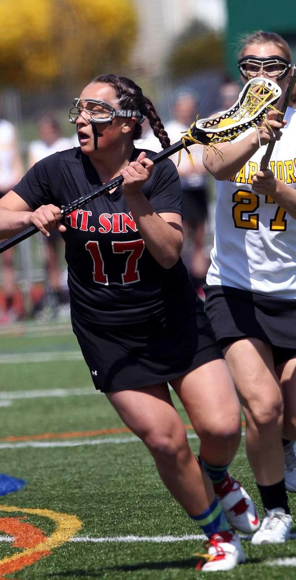 Mt. Sinai's Kasey Mitchell breaks downfield against Wantagh.