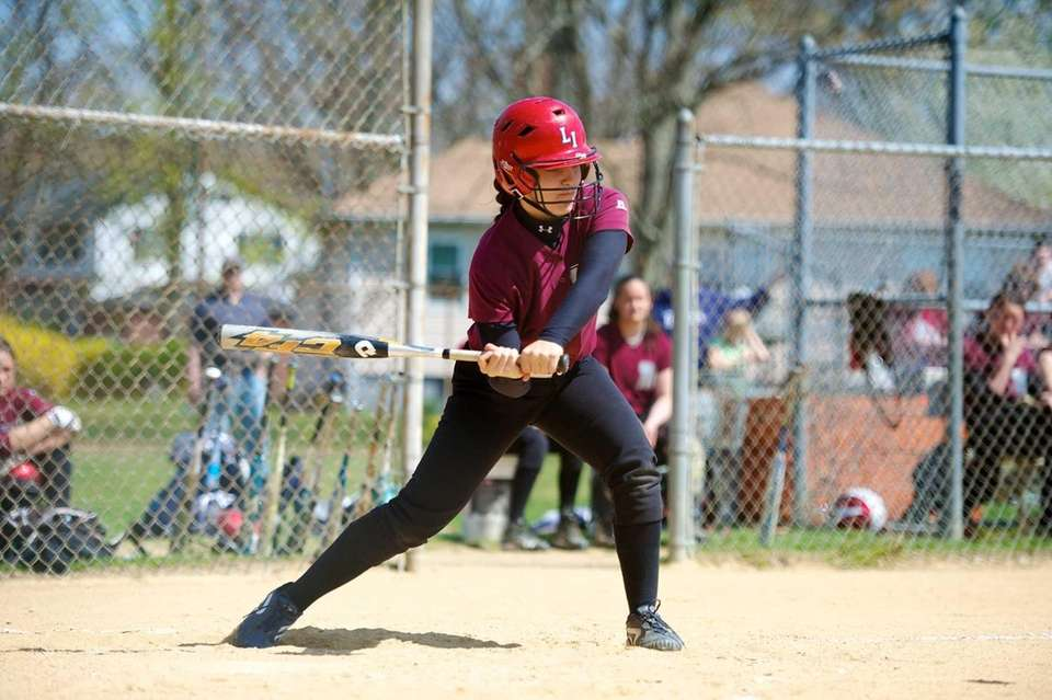 Mepham pitcher Tonimarie Valerano drives in the first