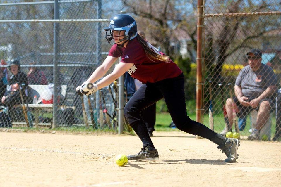 Mepham first baseman Nicole Moccio lays down a