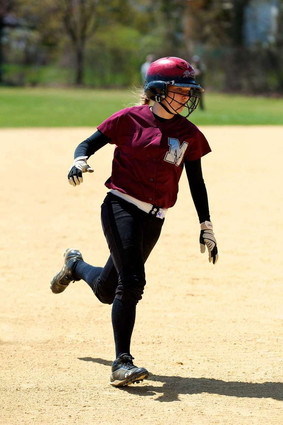 Mepham centerfielder Mary Galgano rounds third base in