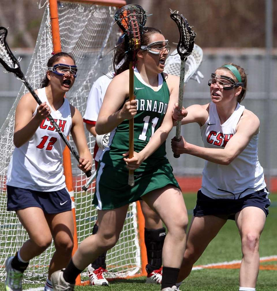 Harborfields' Katie White, surrounded by defenders, controls the