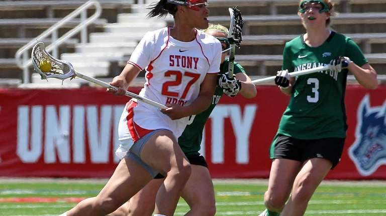 Stony Brook's Demmianne Cook moves past two Binghampton