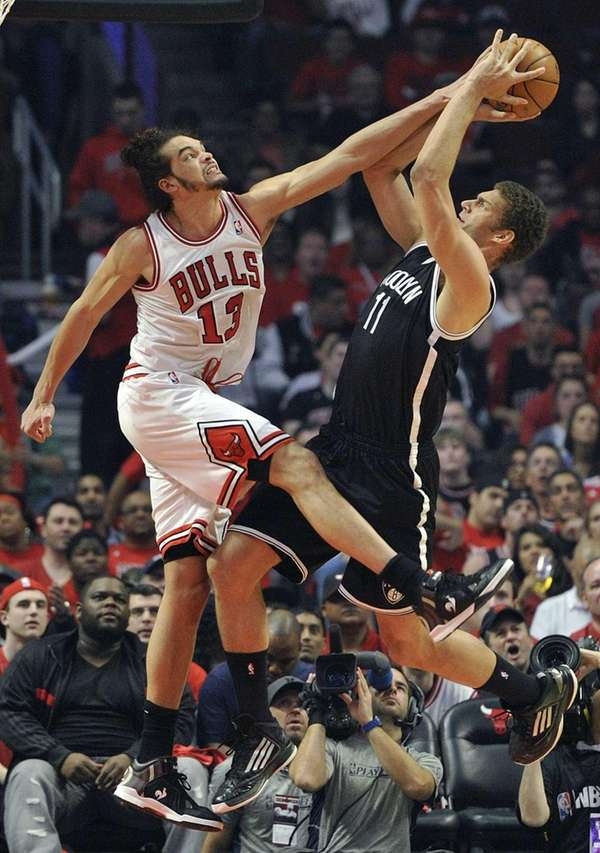 Chicago Bulls' Joakim Noah blocks the shot of