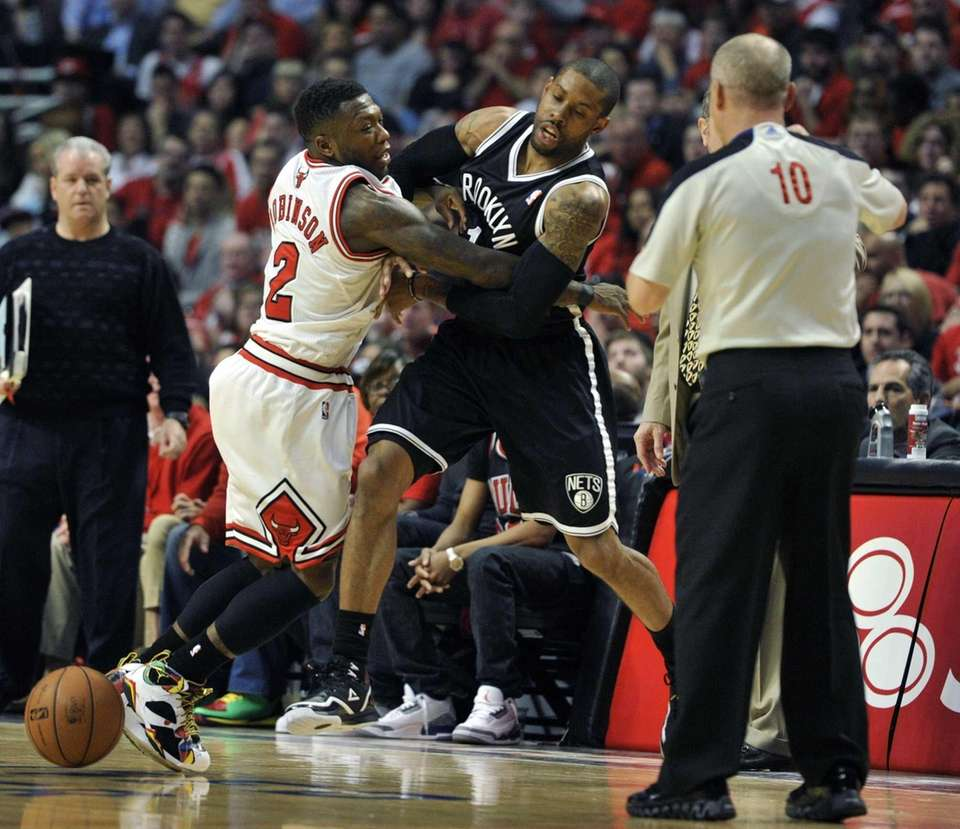 Chicago Bulls' Nate Robinson and Nets' C.J. Watson
