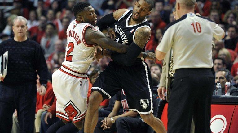 Chicago Bulls' Nate Robinson and Nets' C.J. Watson