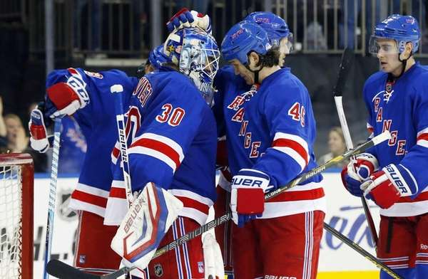 Henrik Lundqvist and Arron Asham of the Rangers