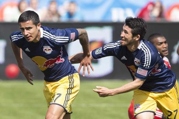 The Red Bulls' Tim Cahill, left, celebrates with