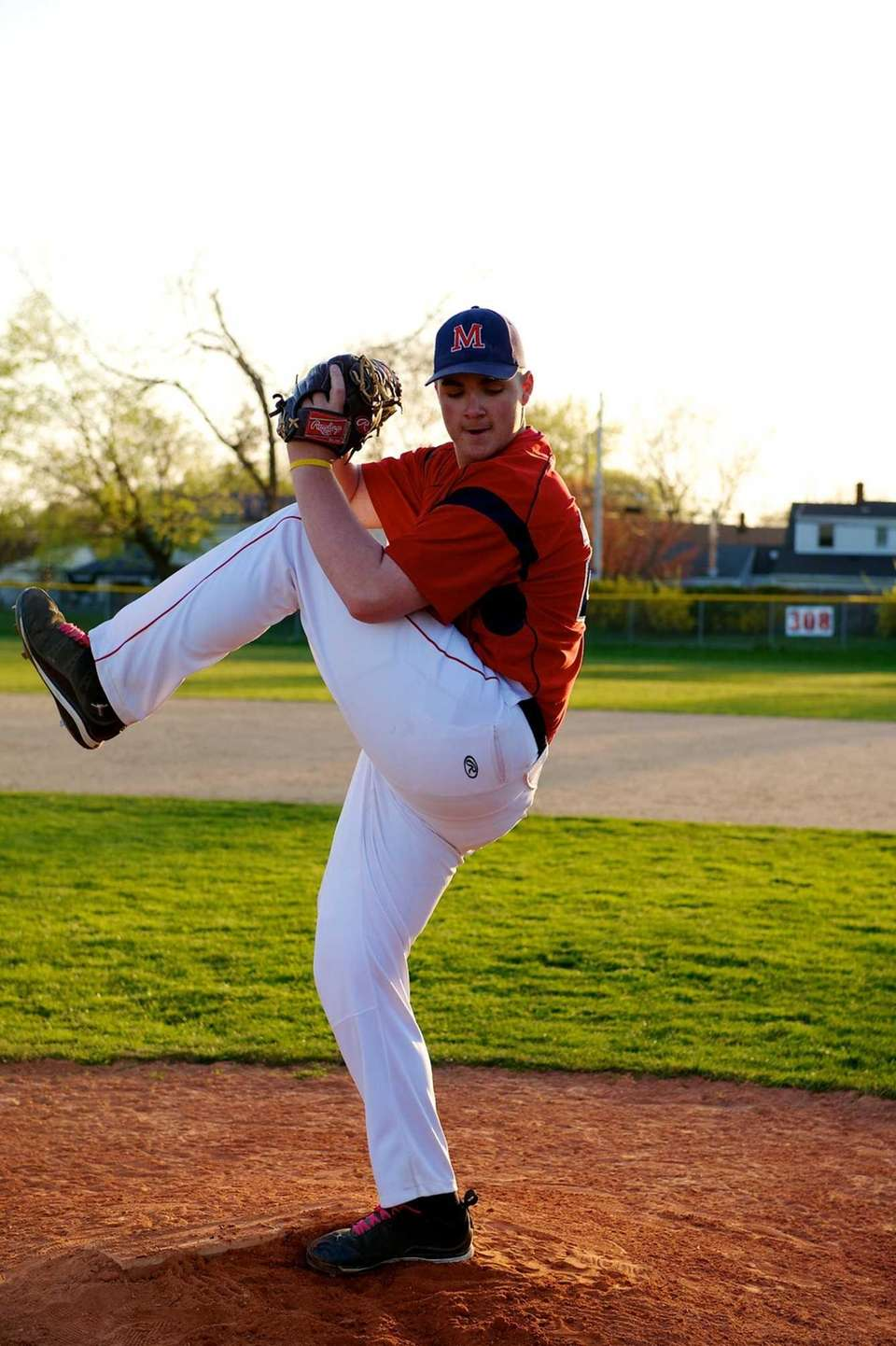 Adam Heidenfelder practices pitching. (April 25, 2013)