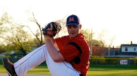 Adam Heidenfelder practices pitching. (April 25, 2013)
