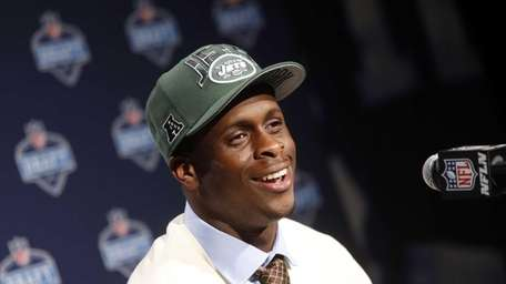 West Virginia's Geno Smith speaks during a news