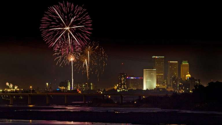 Fireworks launched from ONEOK Freedom Fest line the