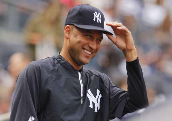 Derek Jeter ooks on from the dugout during