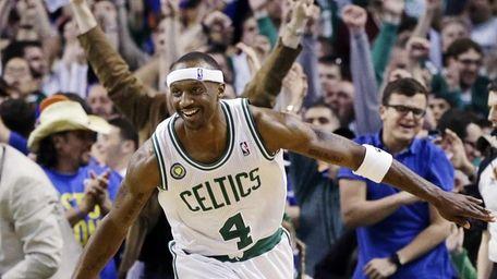 Boston Celtics guard Jason Terry celebrates his basket