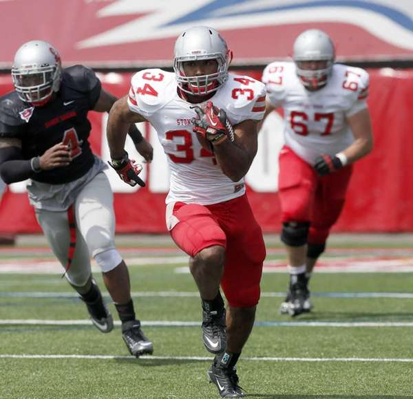 Stony Brook running back Marcus Coker (34) breaks