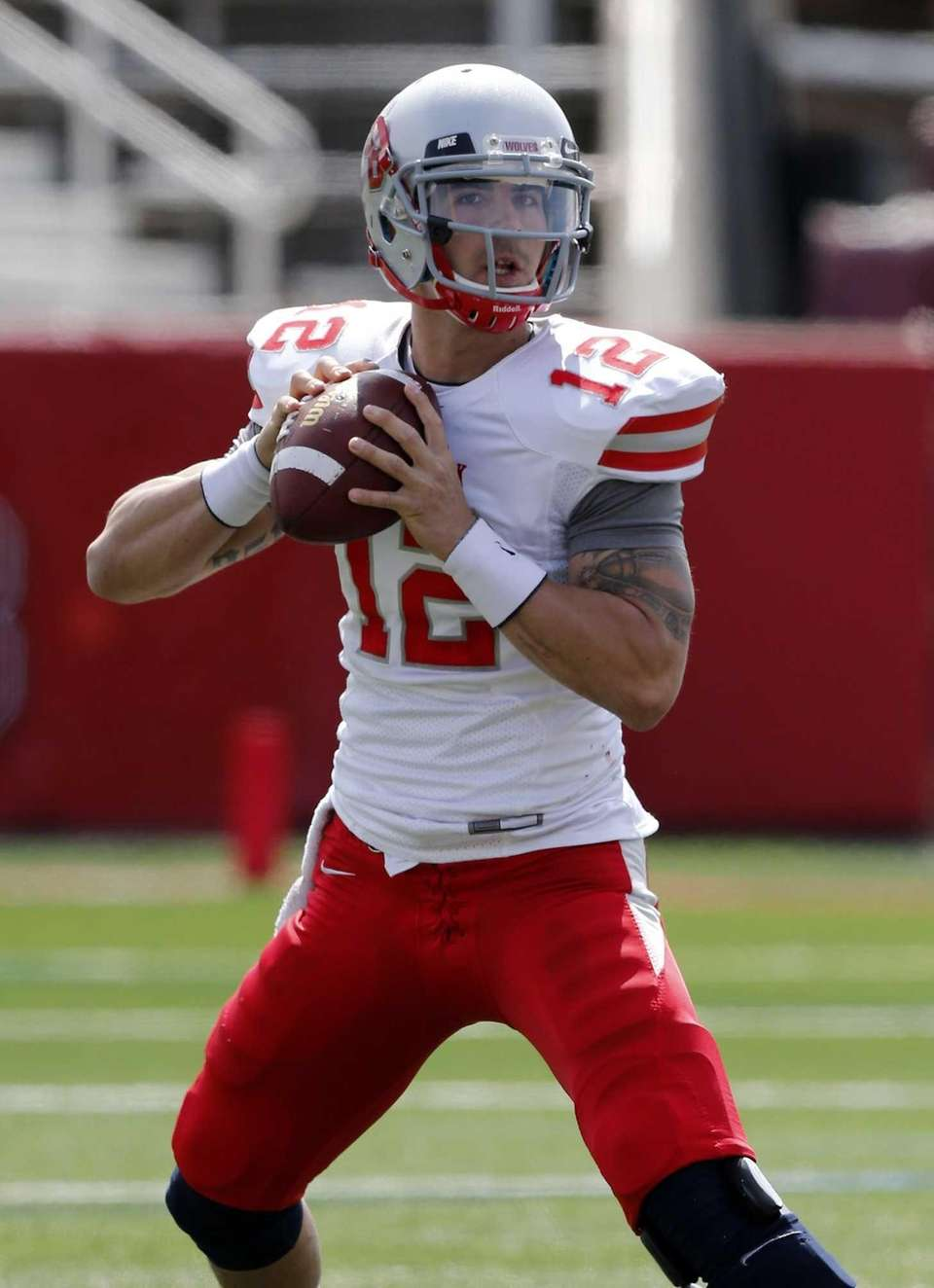 Stony Brook quarterback Lyle Negron (12) sets to