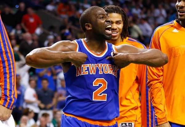 Raymond Felton celebrates after making a three-point shot
