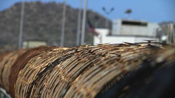 Barb wire surrounds the prison camps at Guantanamo
