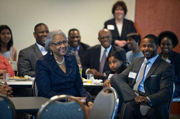 Professor Beverly McQueary Smith laughs with family during