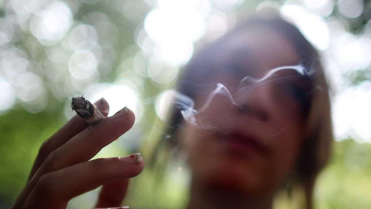 A smoker puffs away at Tompkins Square Park