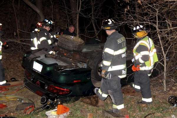 Firefighters respond to the scene of a one-car