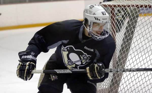 Pittsburgh Penguins' Sidney Crosby participates with the team