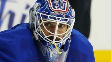 Henrik Lundqvist keeps his eye on the action