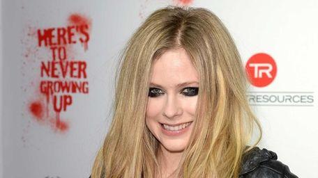 Avril Lavigne arrives for her secret performance at