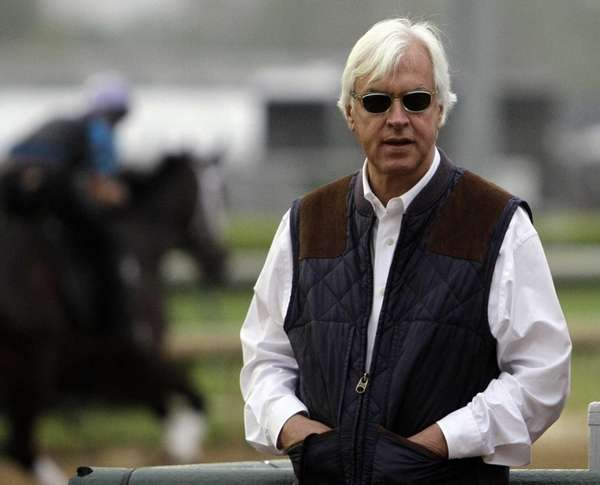Trainer Bob Baffert watches morning workouts at Churchill