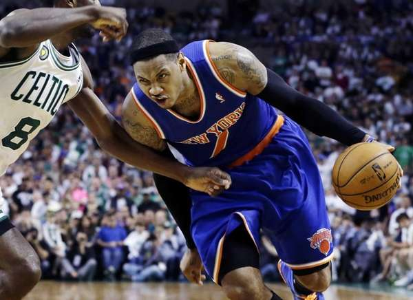 Carmelo Anthony (7) drives against Boston Celtics forward