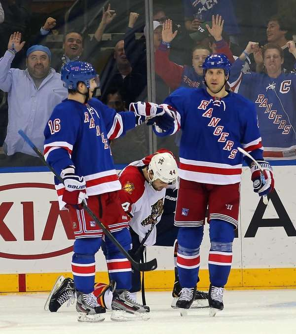 Derick Brassard, left, celebrates his second goal of