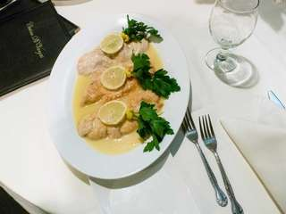 Chicken limone is tender and served in a