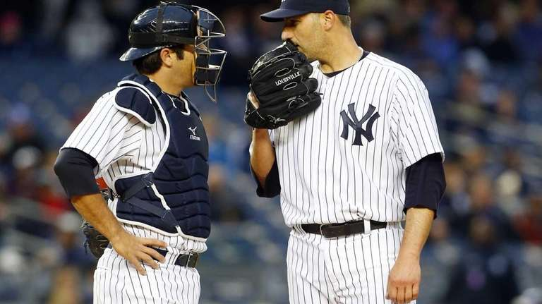 Andy Pettitte talks on the mound with Austin