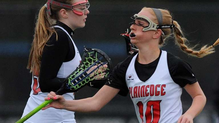 Plainedge's Sara Stephens, right, gets congratulated by teammate
