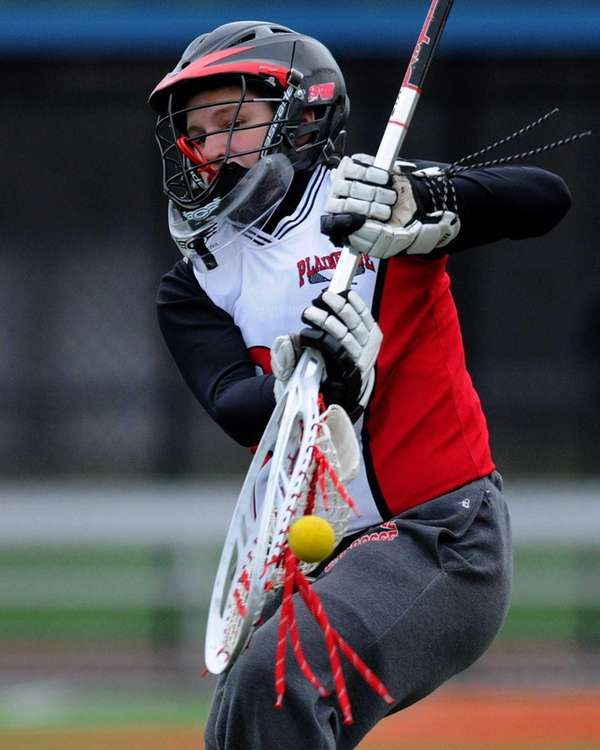 Plainedge's Danielle Harrington makes a save with her