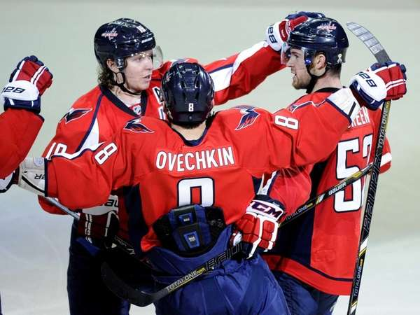 Washington Capitals defenseman Mike Green, right, celebrates his