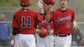 MacArthur's Chris Pappas, left, high fives Sean Carey