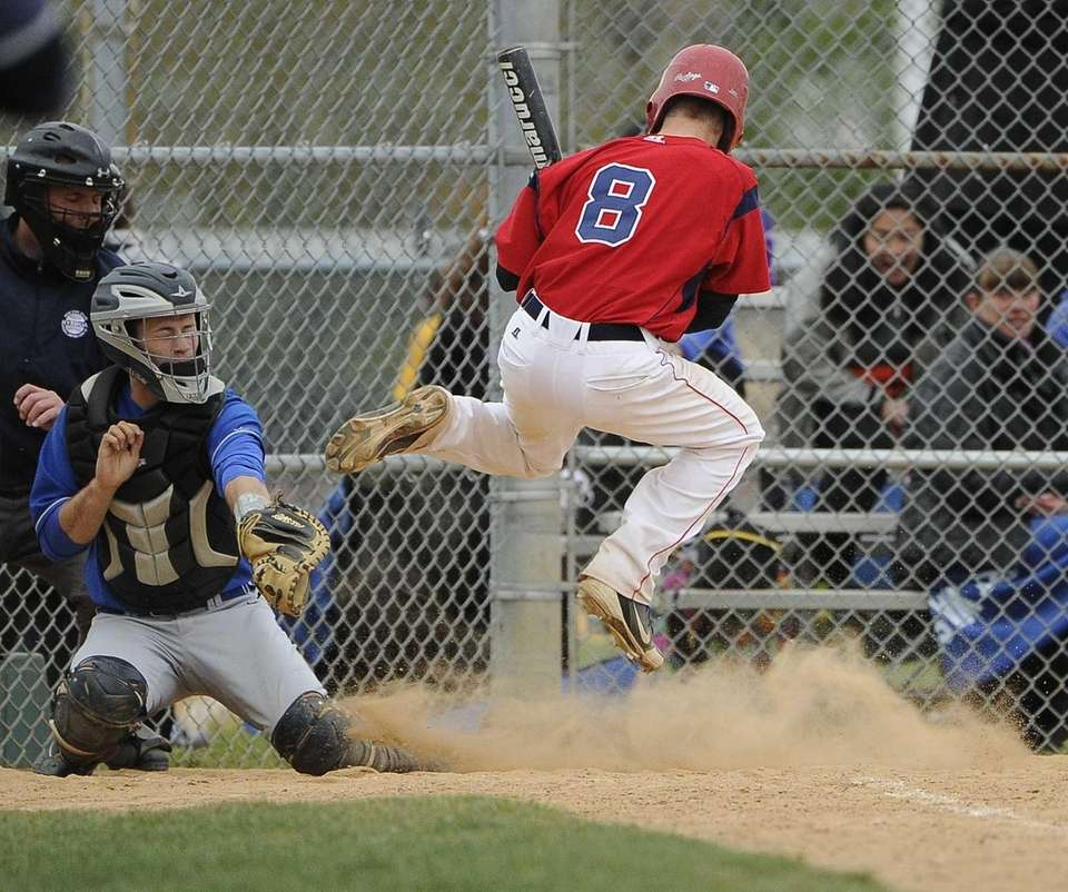MacArthur's Kevin Curtis jumps out of the way