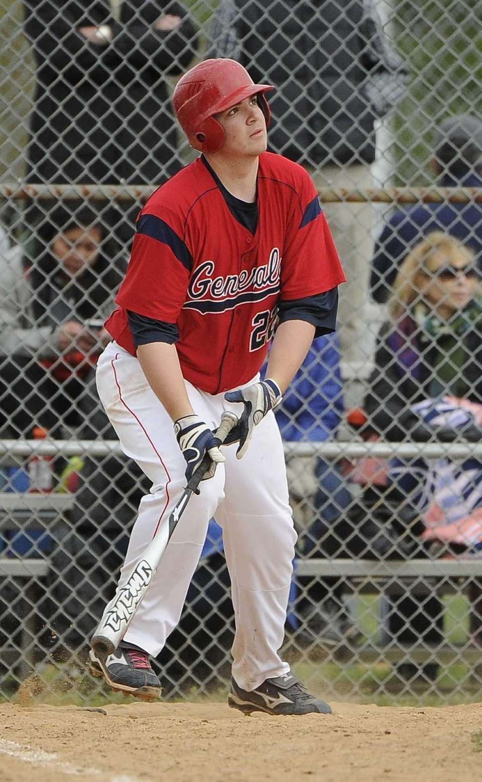 MacArthur batter Adam Heidenfelder watches his triple during
