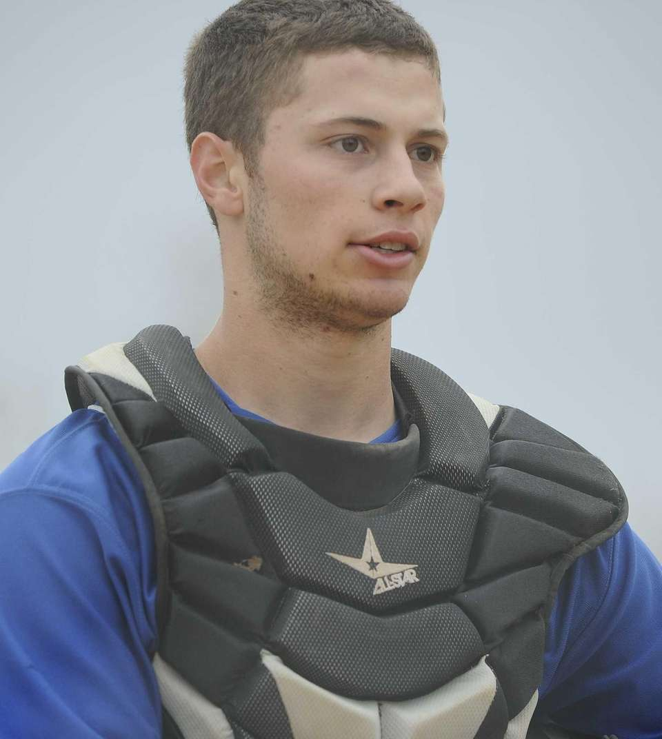 Port Washington catcher Nick Duarte looks on during