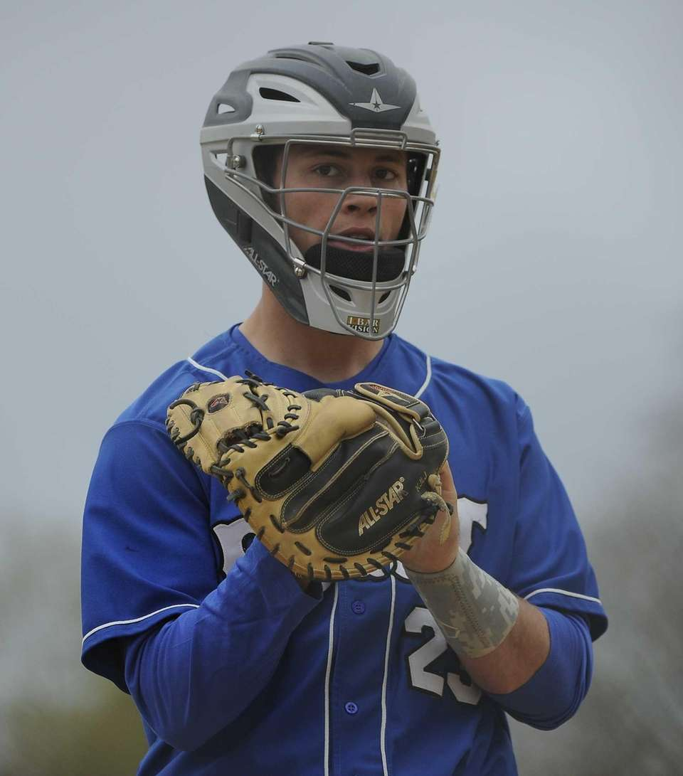 Port Washington catcher Nick Duarte looks on before