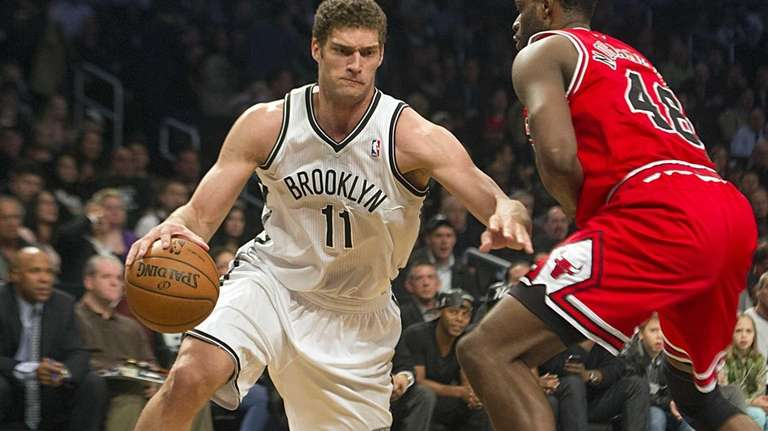 Brook Lopez drives the baseline against the Chicago
