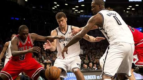 Brook Lopez and Andray Blatche fight for a