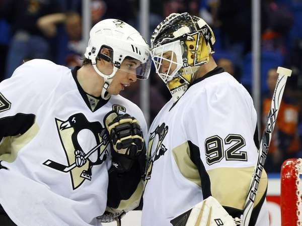 Sidney Crosby #87 and Tomas Vokoun #92 of